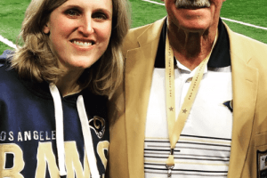 The author and her father, a former professional athlete, on the sidelines before a NFL game.