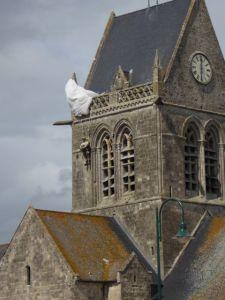 Tribute to paratrooper John Steele in Saint Mere Eglise