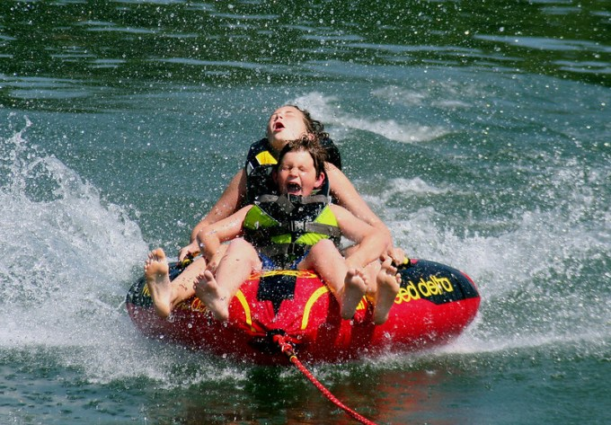 Children tubing on lake