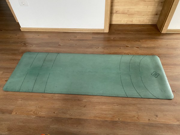 yoga mat, wood floor