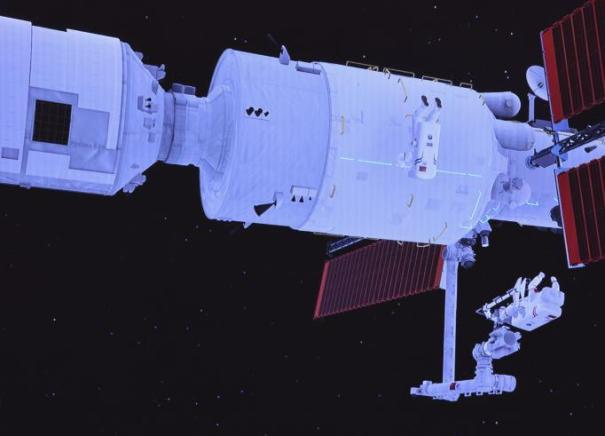 Механическая рука, установленная на основном модуле китайской космической станции Тяньхэ