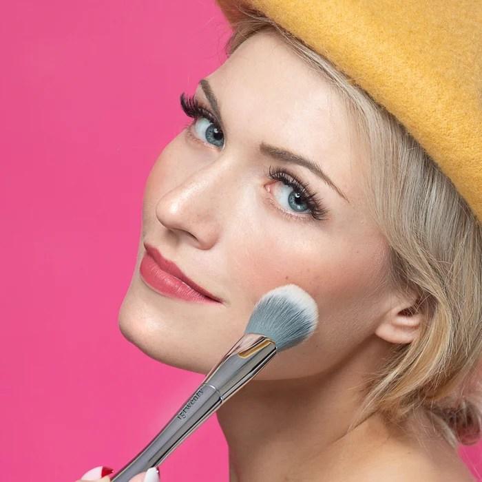 A closeup beauty shot of a woman applying makeup
