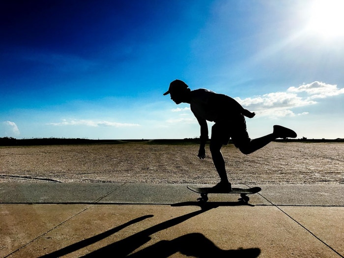 The silhouette of a skateboarder shot using iPhone camera