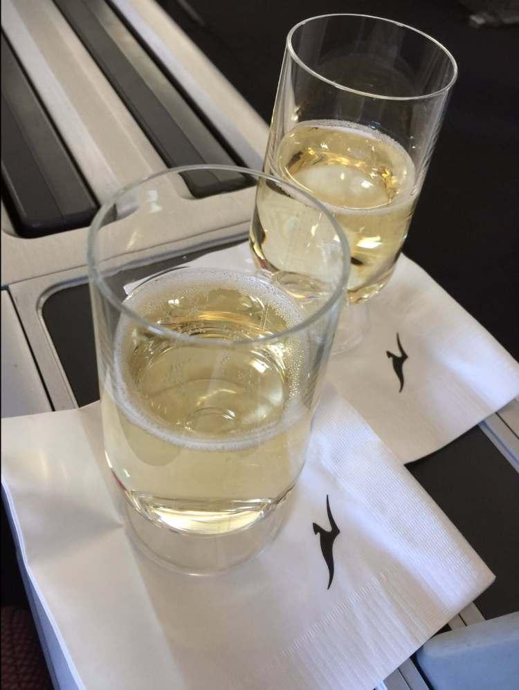 welcome-drink-champagne-Qantas-747-round-world-trip.jpeg
