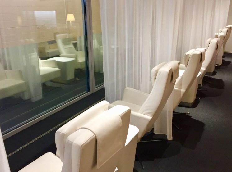 Finnair-Premium-Lounge-couple-chairs-facing-windows-round-world-trip