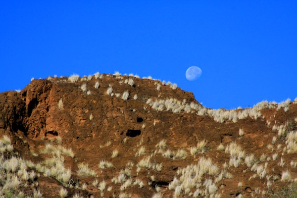 Moon about to set behind Diamond Head crater