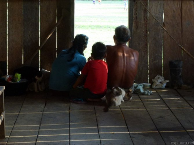 When we got back to the hut, some of the family were perched by the front 'door', watching the daily football match.