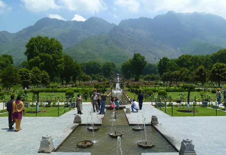 The central axis and channel of Nishat Bagh in 2010 with its terraces sloping up against the hillside and views framed by the chinar trees (Platanus orientalis) (Photo: Jan Haenraets, 2010).