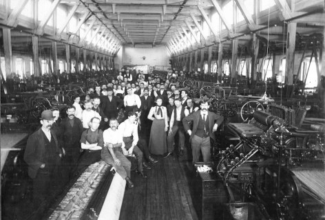 Workers in a mill around 1900 (Source: University of Massachusetts).