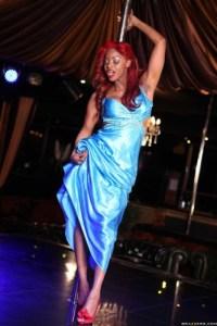jasmine-webb-dances-on-a-pole-and-rides-a-long-white-pole-1