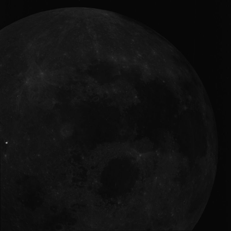 """A possible ship is """"hidden"""" on the middle left side of the image. Is it an alien ship? Click to enlarge Alien spacecraft spotted on surface of the moon"""