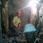 Miners in the larimar mine
