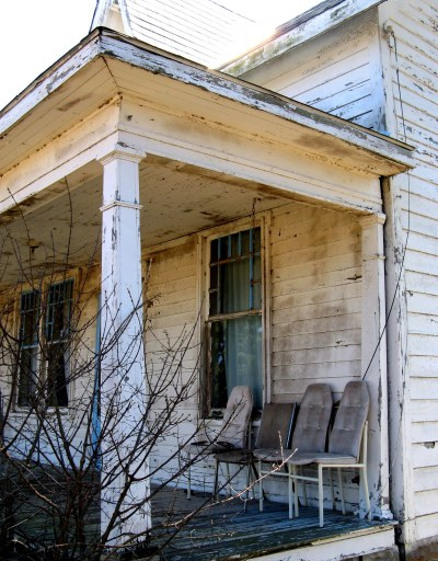 Chairs on an Abandoned Porch