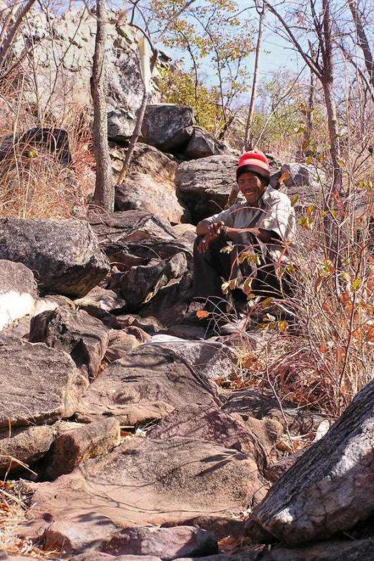Tsodilo Hills Botswana - ExplorationVacation - P9150014 bushman guide on trail
