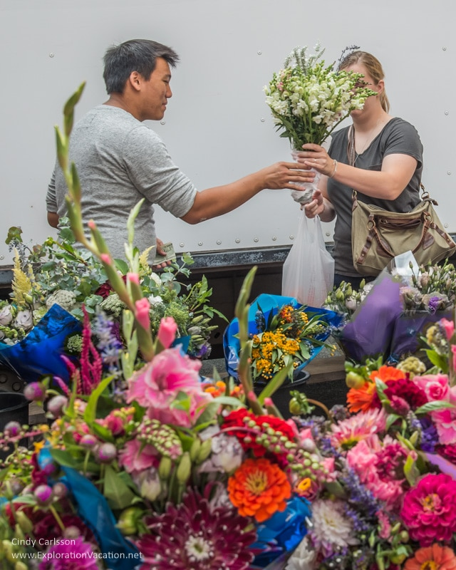 buying flowers at the Saint Paul farmers market Minnesota
