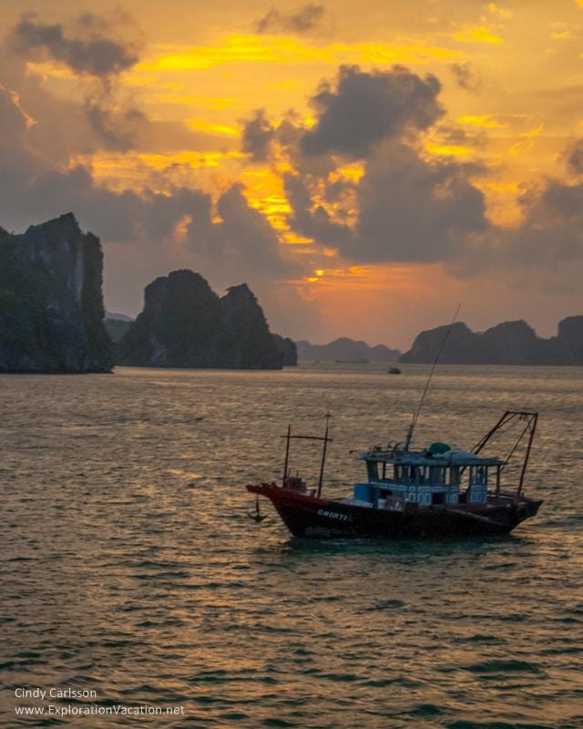 Halong Bay sunrise with fishing boat