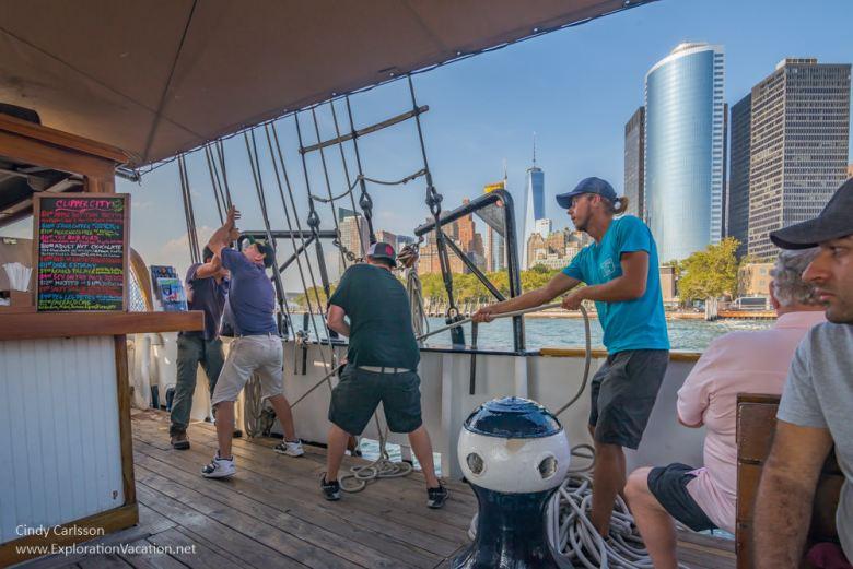 crew raising sails