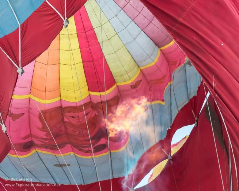 flame from burner inside balloon