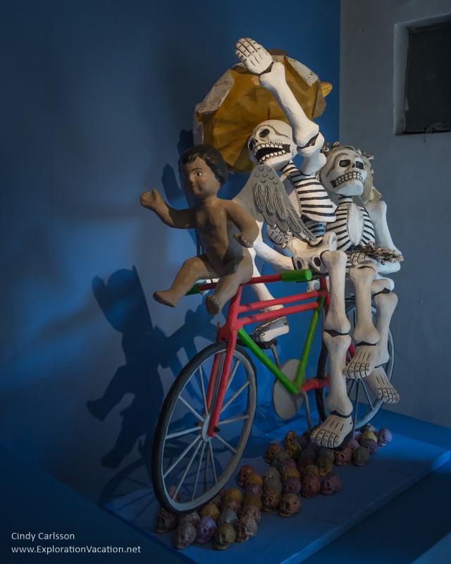 skeleton on a bike