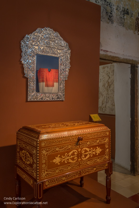 cabinet and mirror with clothing reflection