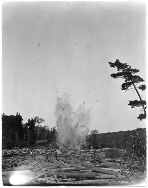 Breaking up a log jam with dynamite at Big Falls, circa 1890. Photo from the Minnesota Historical Society collection, locator number HD5.44 r9.