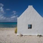 Historic salt worker hut along the beach on Bonaire - Explorationvacation.net