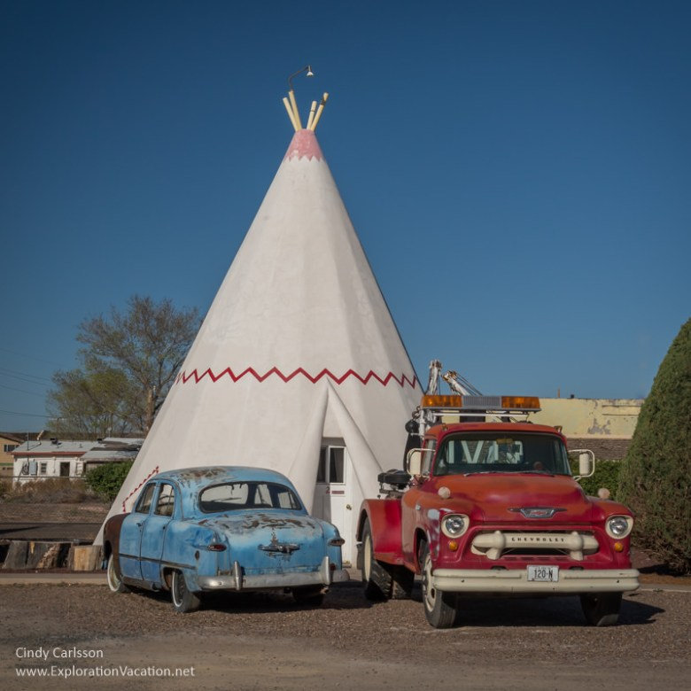 Antique cars in front of a fake tee pee