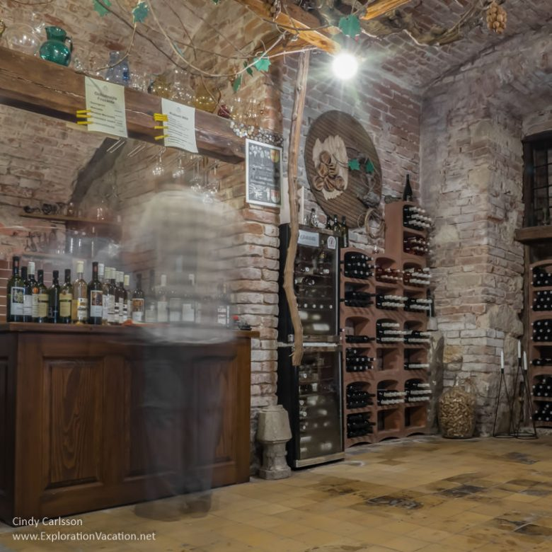 blurred figures inside the wine cellar