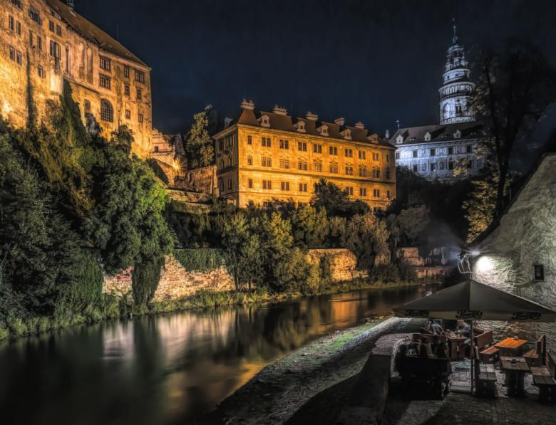 night scene of the castle above the river