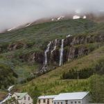 Waterfall above houses