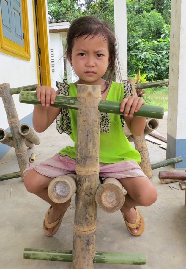 little lao girl on bamboo swing
