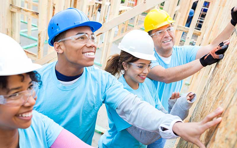 Image of people including teens at an Americorp construction site