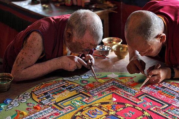 LADAKH, INDIA - SEPTEMBER 03, 2011: Buddhist monks making sand m