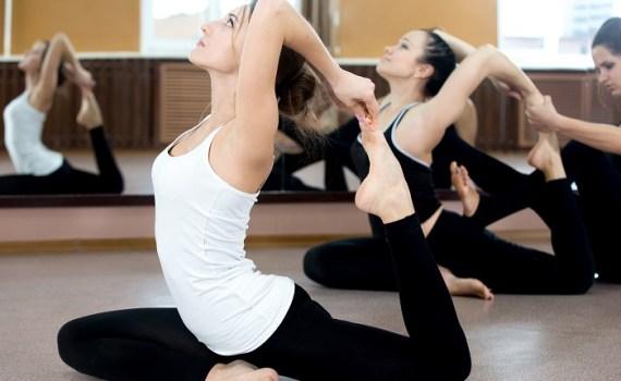 Two Yogi Female Exercising In Class
