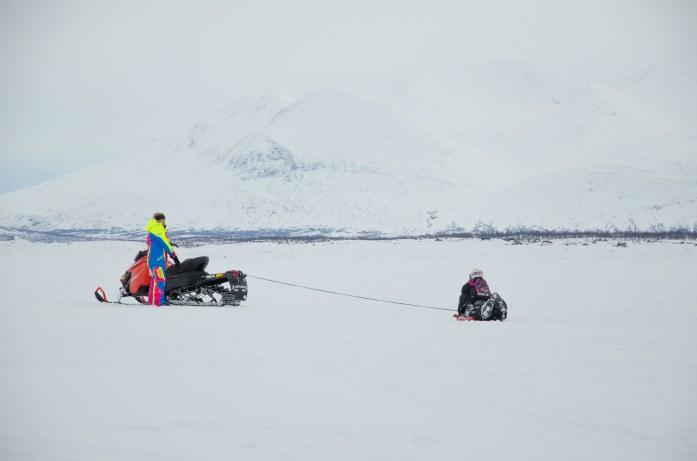 snowmobile in swedish lapland - explore a little more