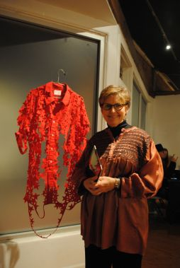 Ann Morton beside one of her pieces at Modified Arts.
