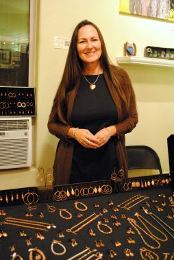 Suzy Mound of Jerome uses copper in much of her jewelry, an appropriate material considering her locale. Here, she's sharing space with other artists at RooPho Realty.
