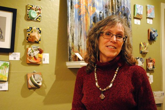 Every First Friday, the RooPho Realty office turns into a gallery space. This is Elizabeth Gerstner of Clarkdale with wall plaques that she makes from found objects, cast off from the days of mining in central Arizona.