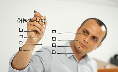 Employee with checklist