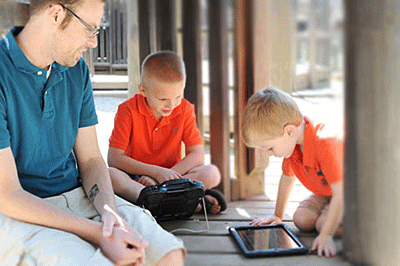Speech Communication AT - Two boys interacting with speech generating devices