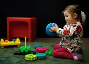 Girl Playing with Ball