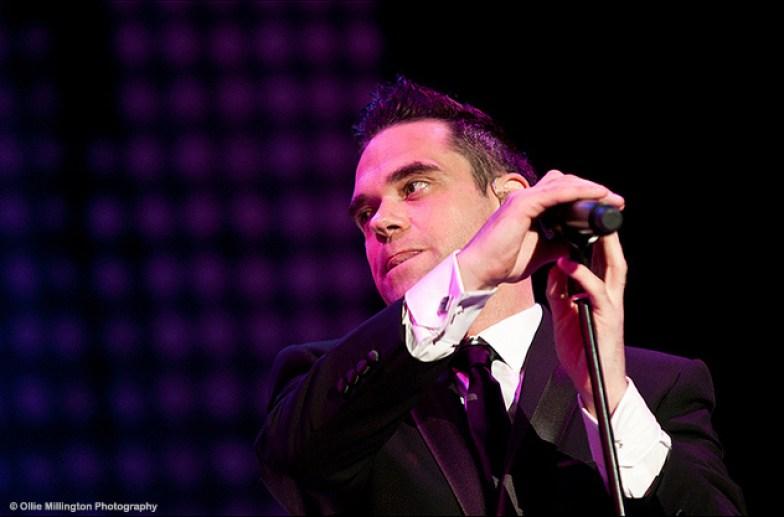 JK as Robbie Williams