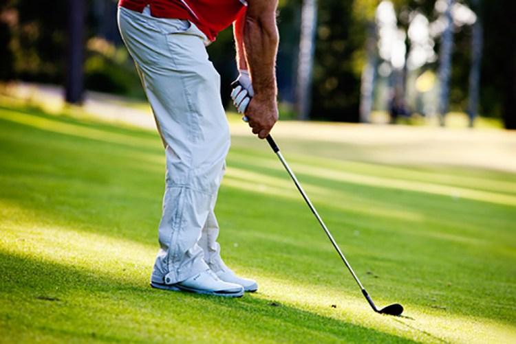 Golfer close up swing