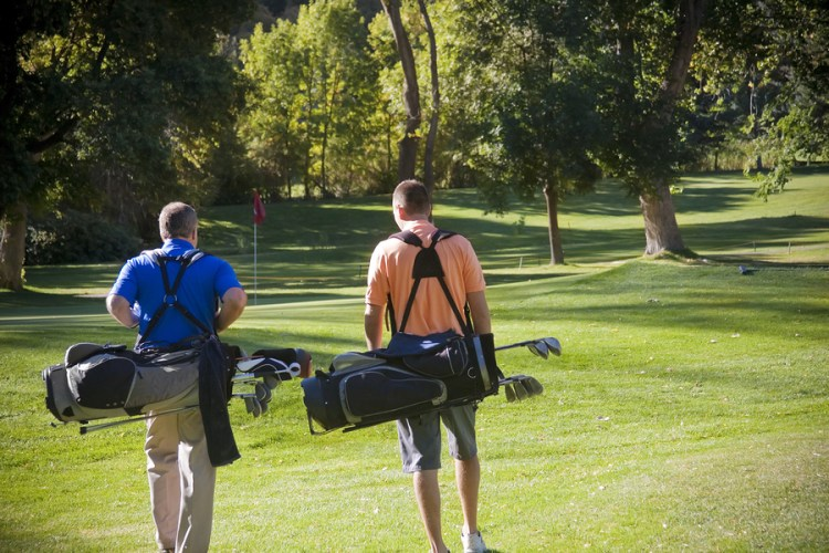 golfers walking the Concession golf course