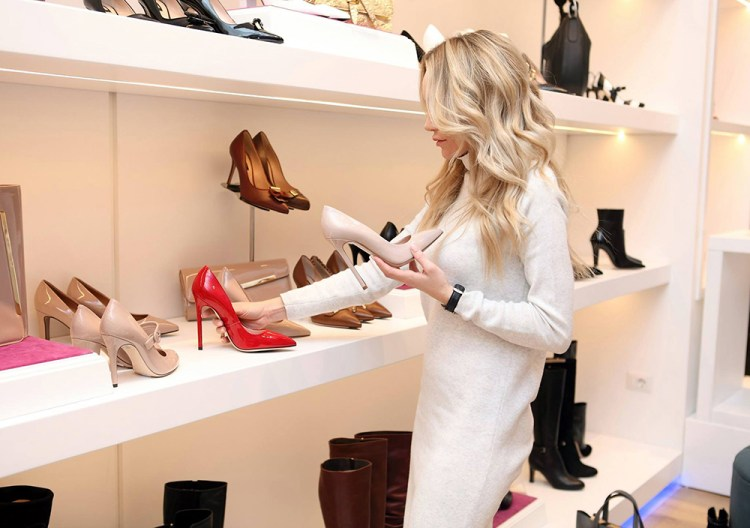 Blonde Woman shopping for shoes at University Town Center