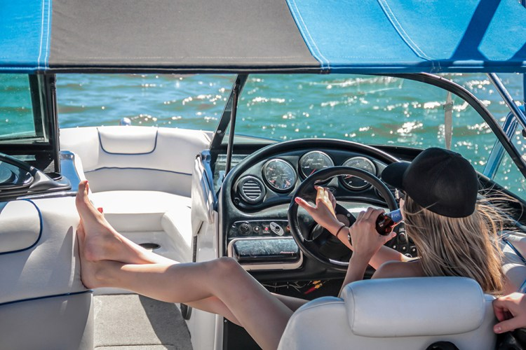 Woman driving boat on lake