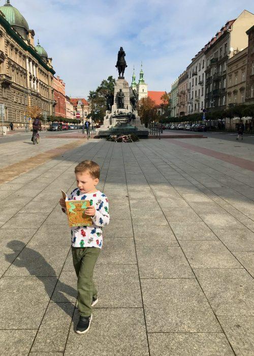 Miles walking through Krakow, reading legends out loud