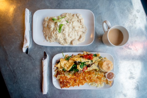 1. Signs for Gil's Goods, The Murray Bar and the Murray Hotel line West Park Street in Livingston. / 2. A plate of biscuits, gravy, veggie eggs and hash browns at Gil's Goods.
