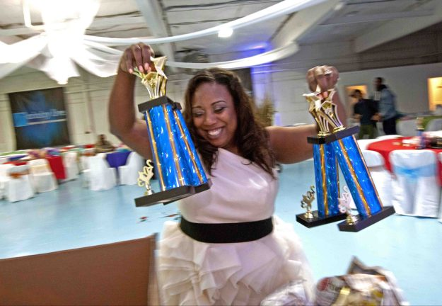 1. Girls wait to audition for the Camden Sophisticated Sisters. / 2. Tawanda Jones prepares trophies at a banquet honoring the team.