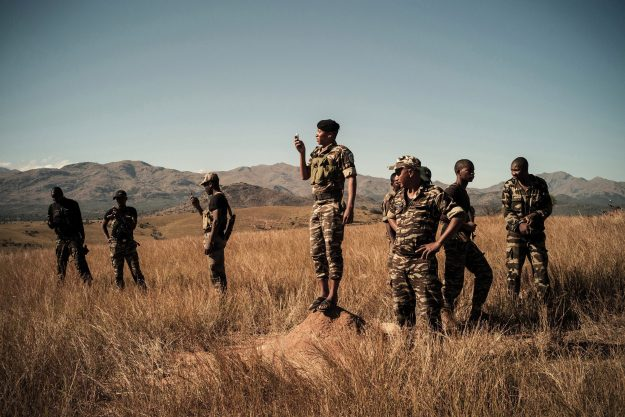 1. A police officer from the Coup d'Arrêt military operation stopped his team to make a phone call. / 2. Children keep zebus in Ahovotsotse. It is considered impossible for a cattle owner to expose his zebus in the open like this, unless he himself is a dahalo.